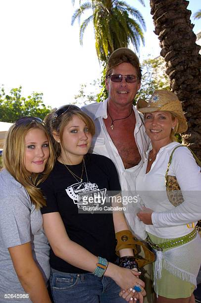 David Hasselhoff poses with daughters TaylorAnn and Hayley and his wife Pamela on Lincoln Road March 29 2005 in Miami Beach Florida
