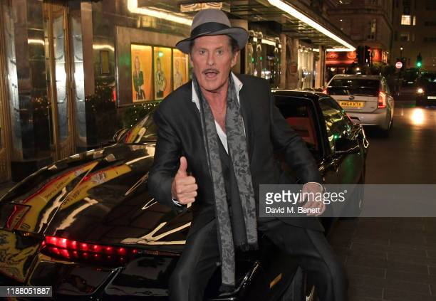 """David Hasselhoff poses with KITT from Knight Rider at the gala party to celebrate David Hasselhoff joining the cast of the West End production of """"9..."""