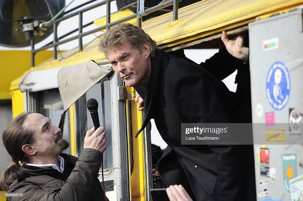 David Hasselhoff speaks to the crowd 'Save the Wall' Protest at East Side Gallery on March 17, 2013 in Berlin, Germany. A real estate developer is planning to build a 14-storey apartment building between the East Side Gallery and the Spree River and needs to remove the Wall section in order to allow access to the construction site. Protesters managed to temporarily halt the dismantling of the section on March 1. Critics, including East Side Gallery mural artists and Spree River embankment development opponents, decry the move, citing the importance of the East Side Gallery's status as a protected landmark and a major tourist attraction. The East Side Gallery is approximately 1.3 kilometers long.