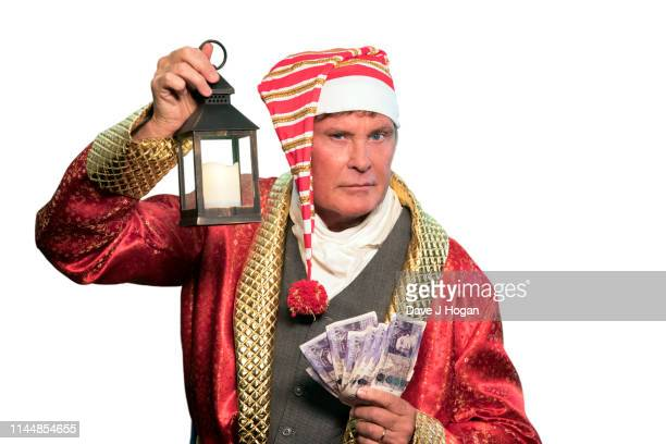 David Hasselhoff stars As Ebenezer Scrooge In Scrooge The Funny Family Spectacular on April 24 2019 in London United Kingdom The production is...