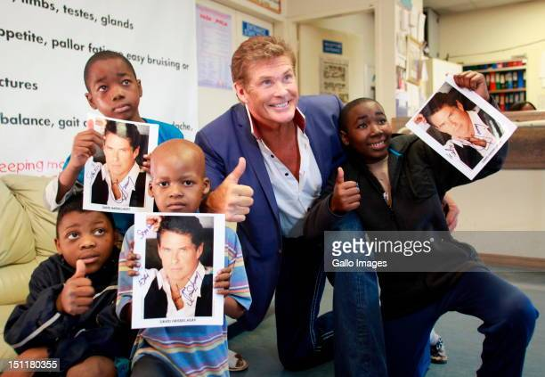 David Hasselhoff talks to young cancer patients at the Chris Hani Baragwanath hospital on August 31 2012 in Johannesburg South Africa Hasselhoff...
