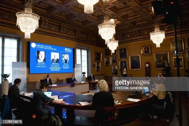 David Haviland, member of the Nobel Committee for Physics, Goran K Hansson, Secretary General of the Academy of Sciences, and Ulf Danielsson, member...