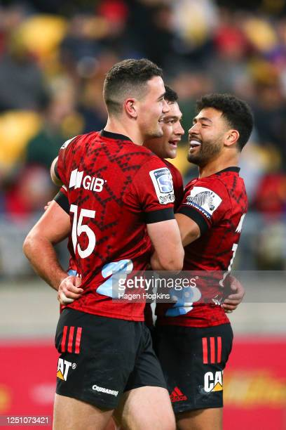 David Havili of the Crusaders celebrates his try with Will Jordan and Richie Mo'unga during the round 2 Super Rugby Aotearoa match between the...