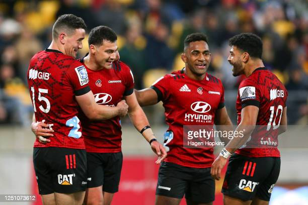 David Havili of the Crusaders celebrates his try with Will Jordan, Sevu Reece and Richie Mo'unga during the round 2 Super Rugby Aotearoa match...