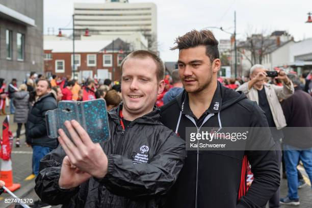David Havili of the Crusaders greets fans during a parade at Christchurch Art Gallery on August 8 2017 in Christchurch New Zealand The Crusaders beat...