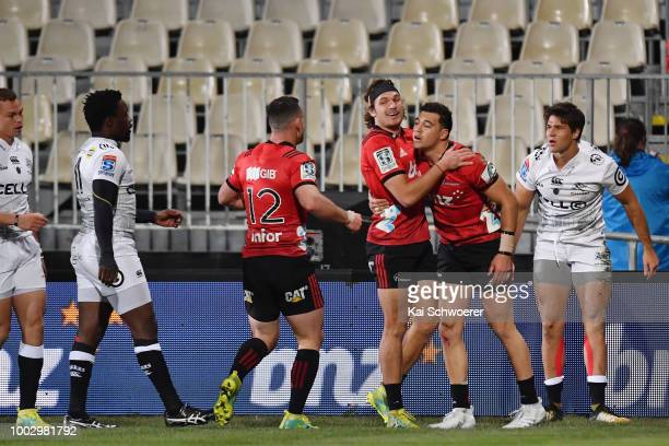 David Havili of the Crusaders is congratulated by team mates after scoring a try during the Super Rugby Qualifying Final match between the Crusaders...