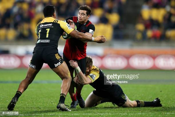 David Havili of the Crusaders is tackled by Julian Savea of the Hurricanes during the round 17 Super Rugby match between the Hurricanes and the...