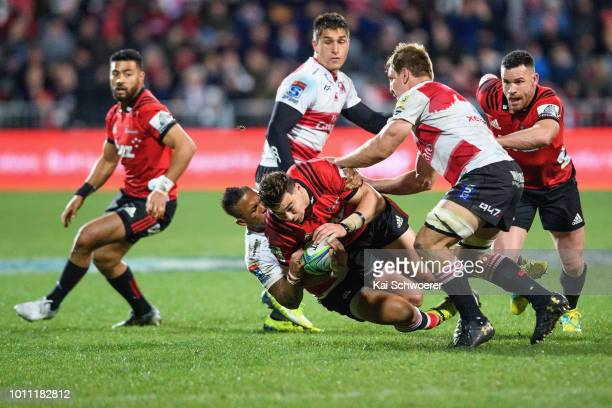 David Havili of the Crusaders is tackled during the Super Rugby Final match between the Crusaders and the Lions at AMI Stadium on August 4 2018 in...