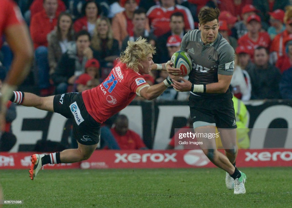David Havili of the Crusaders tackled by Faf de Klerk of the Lions during the Super Rugby Final match between Emirates Lions and Crusaders at Emirates Airline Park on August 05, 2017 in Johannesburg, South Africa.