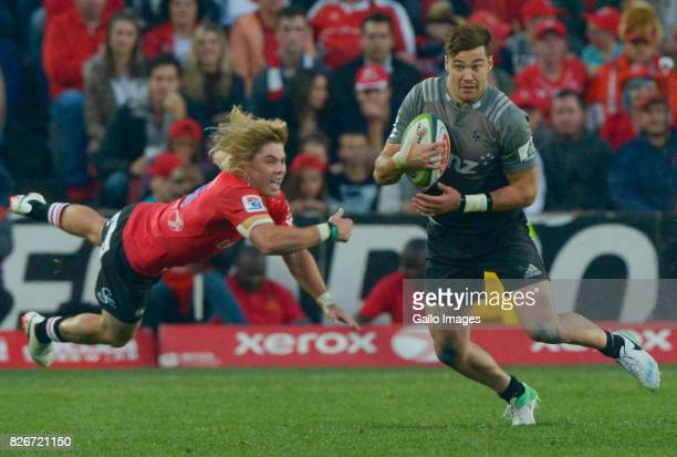 David Havili of the Crusaders tackled by Faf de Klerk of the Lions during the Super Rugby Final match between Emirates Lions and Crusaders at...
