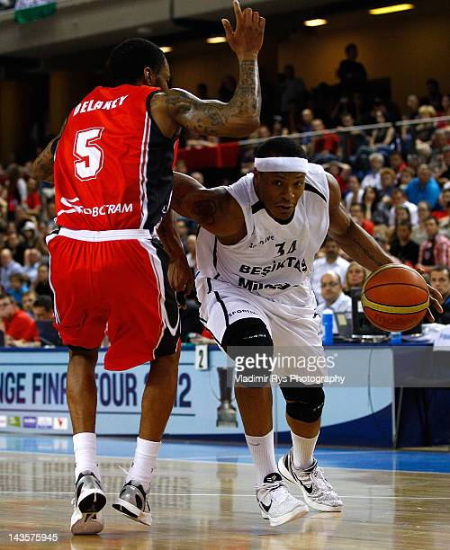 David Hawkins of Besiktas attacks as Malcolm Delaney of Chalon defends during the FIBA Europe EuroChallenge Final Four final game between Besiktas...