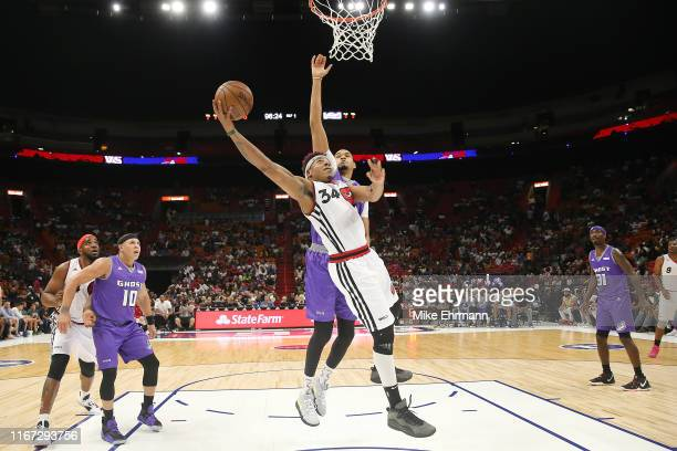 David Hawkins of Trilogy goes up for a layup against Chris Johnson of the Ghost Ballers during week eight of the BIG3 three on three basketball...