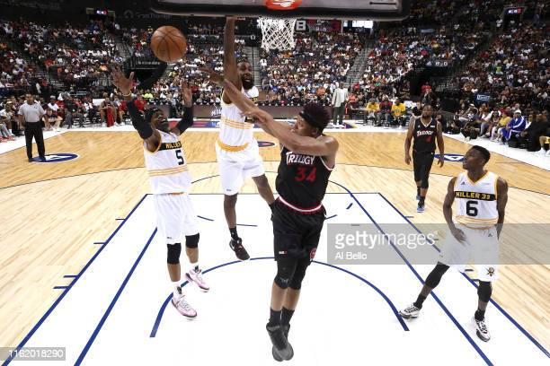 David Hawkins of Trilogy looks to pass against Stephen Jackson of Killer 3s during week four of the BIG3 three-on-three basketball league at Barclays...
