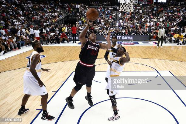 David Hawkins of Trilogy shoots against Frank Session of Killer 3s during week four of the BIG3 three-on-three basketball league at Barclays Center...