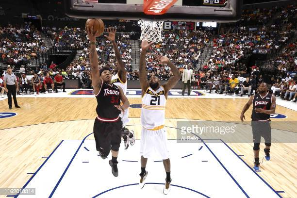 David Hawkins of Trilogy shoots against Josh Powell of Killer 3s during week four of the BIG3 three-on-three basketball league at Barclays Center on...