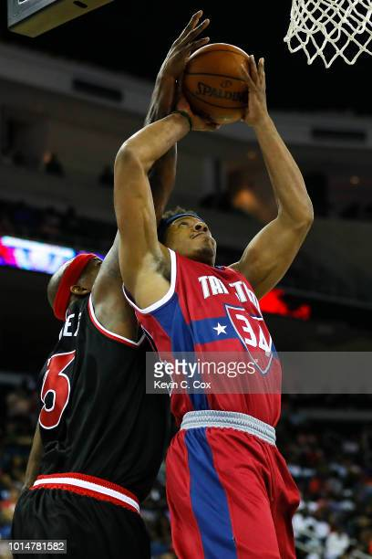 David Hawkins of TriState attempts a layup against Al Harrington of Trilogy during week eight of the BIG3 three on three basketball league at...