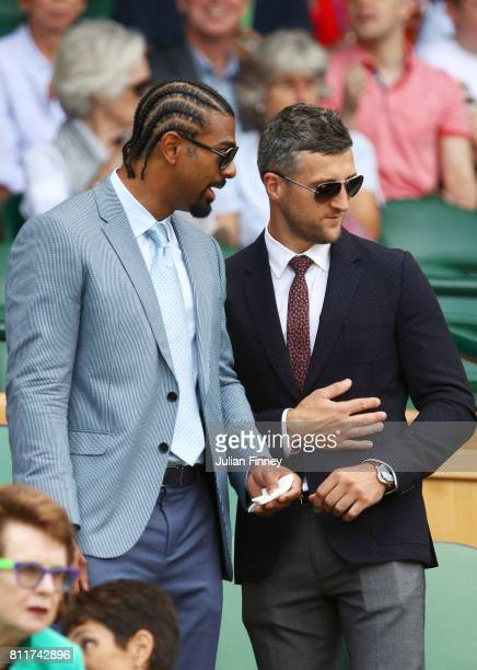 David Haye and Carl Froch look on from the centre court royal box on day seven of the Wimbledon Lawn Tennis Championships at the All England Lawn...
