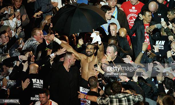 David Haye celebrates winning the Heavyweight Fight against Dereck Chisora as he leaves the arena at Boleyn Ground on July 14 2012 in London England