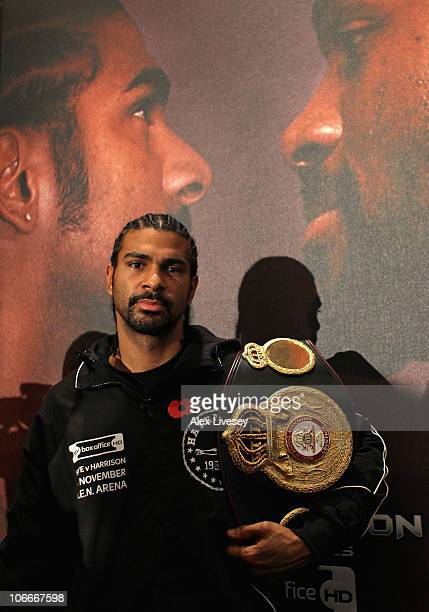 David Haye holds his WBA belt in front of the official fight night poster during a press conference ahead of his WBA Heavyweight Title fight against...