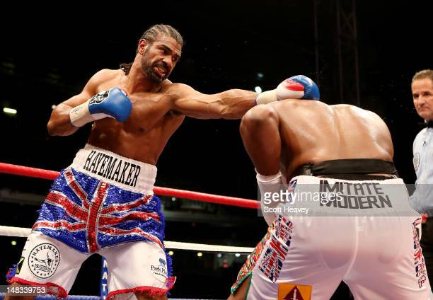 David Haye in action with Dereck Chisora during their vacant WBO and WBA International Heavyweight Championship bout on July 14 2012 in London England