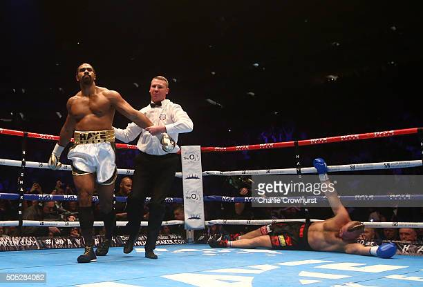 David Haye of England is pushed away by the referee after knocking out Mark De Mori of Australia during their International heavyweight contest at...