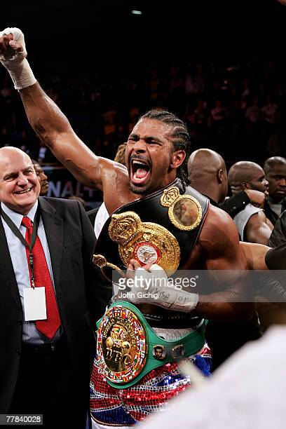 David Haye of Great Britain celebrates winning the WBA and WBC Cruiserweight title fight between David Haye and JeanMarc Mormeck of France at the...