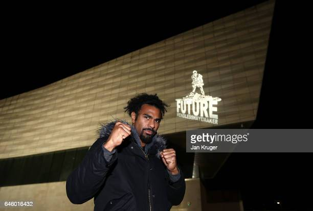 David Haye poses with a projected image of him knocking out Tony Bellew by artist ENDLESS on the Museum of Liverpool ahead of their heavyweight fight...