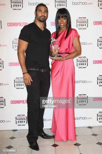 David Haye poses with Debbie Harry in the press room at the Cosmopolitan Ultimate Women Of The Year Awards 2011 held at Banqueting House on November...