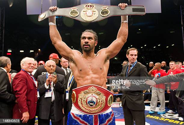 David Haye raises his belt trophy after winning the WBO International and WBA Intercontinental Heavyweight Championship fight at the West Ham...