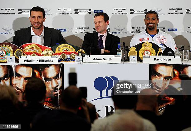 David Haye smiles as he listens to Wladimir Klitschko during the David Haye v Wladimir Klitschko Press Conference at the Park Plaza Hotel on May 10...
