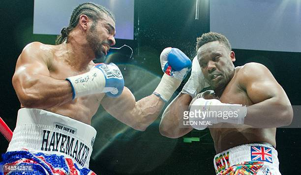 David Haye throws a punch at Dereck Chisora during the WBO International and WBA Intercontinental Heavyweight Championship fight at the West Ham...
