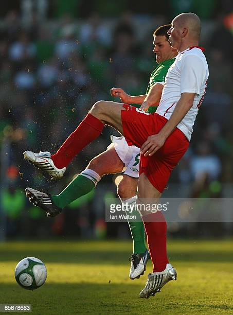 David Healy of Northern Ireland and Mariusz Lewandowski of Poland in action during the FIFA2010 World Cup Qualifier match between Northern Ireland...