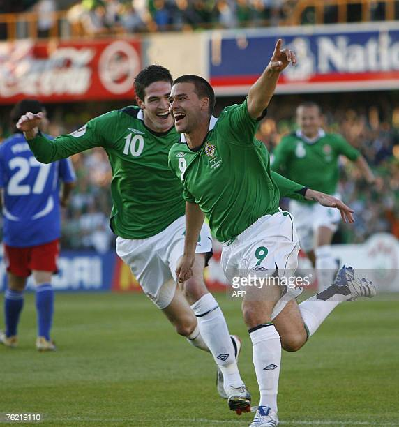 David Healy of Northern Ireland celebrates with team mate Kyle Lafferty 22 August 2007 during the Euro 2008 qualifier match against Liechtenstein at...
