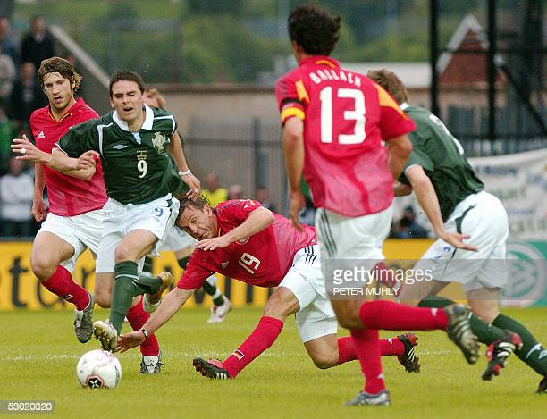 David Healy of Northern Ireland goes upfield as Germany's Bernd Schneider and Robert Huth during their World Cup Qualifier football match at Windsor...