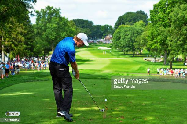 David Hearn of Canada hits his tee shot on the 13th hole during the first round of the 95th PGA Championship on August 8, 2013 in Rochester, New York.