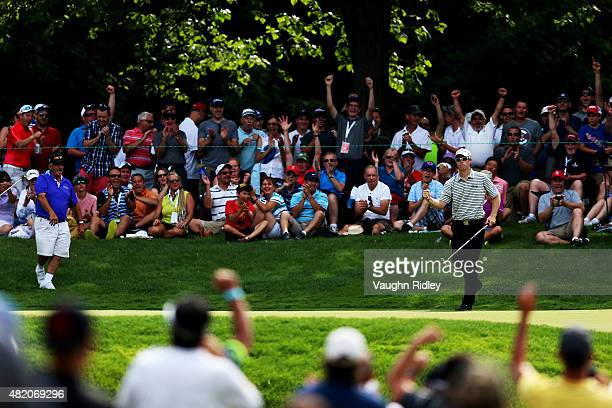 David Hearn of Canada reacts after putting for birdie on the 13th green during the final round of the RBC Canadian Open at Glen Abbey Golf Club on...
