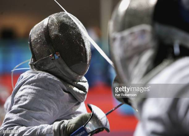 David Heaton of Great Britain competes against eventual Gold Medal winner Robert Wysmierski of Poland in the Mens Individual Sabre Category B on...