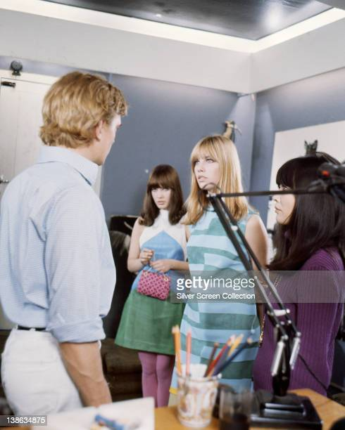 David Hemmings British actor Gillian Hills British actress and Jane Birkin British actressboth dressed in sixties fashions in a scene from the film...