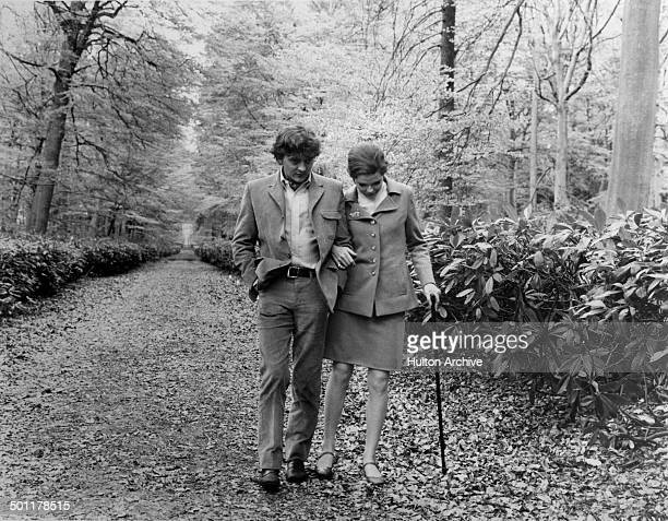 David Hemmings helps Samantha Eggar walk in a scene of the movie The Walking Stick circa 1970