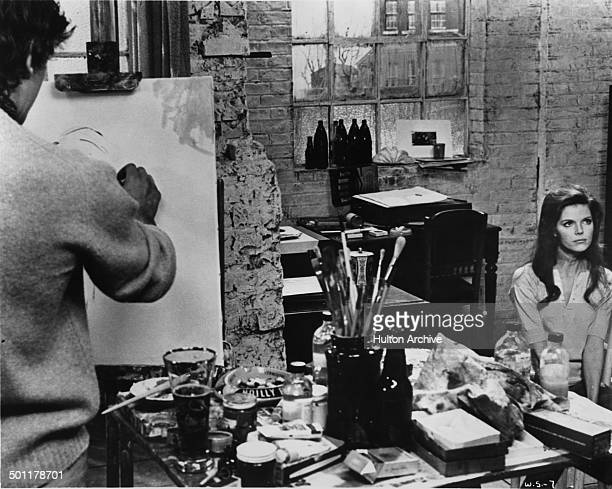 David Hemmings paints a picture of Samantha Eggar in a scene of the movie The Walking Stick circa 1970