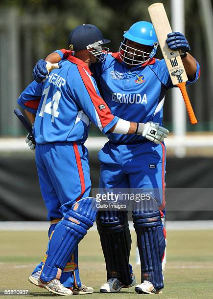 David Hemp of Bermuda celebrates reaching his century with captain Irving Romaine during the ICC Mens Cricket World Cup qualifier match between Kenya...