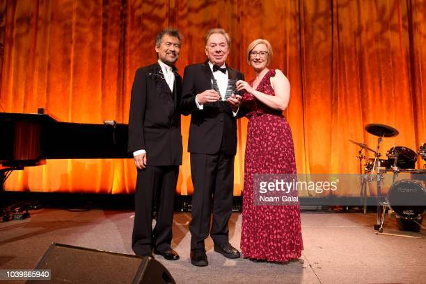 David Henry Hwang Andrew Lloyd Webber and Heather Hitchens pose onstage during the American Theatre Wing Centennial Gala at Cipriani 42nd Street on...