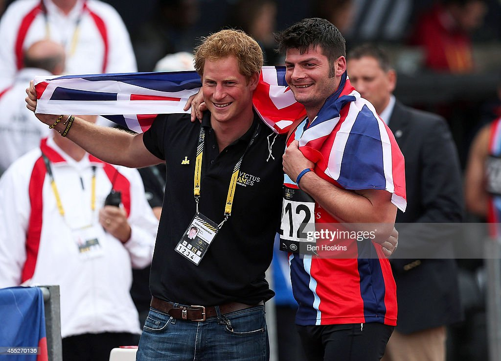 David Henson of Great Britain celebrates with Prince Harry after winning the men's 200m Ambulant IT2 race on Day One of the Invictus Games at Lee Valley Athletics Stadium on September 11, 2014 in London, England.
