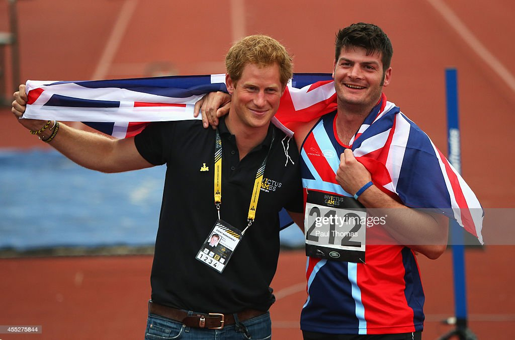 David Henson of Great Britain celebrates with Prince Harry after winning the gold medal in the 200m Men Ambulant IT2 final during day 1 of the Invictus Games, presented by Jaguar Land Rover at Lee Valley Athletics Centre on September 11, 2014 in London, England.
