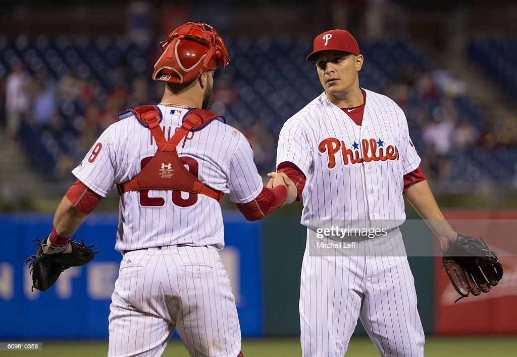 David Hernandez #30 of the Philadelphia Phillies shakes hands with Cameron Rupp #29 after the game against the Chicago White Sox at Citizens Bank Park on September 21, 2016 in Philadelphia, Pennsylvania. The Phillies defeated the White Sox 8-3.