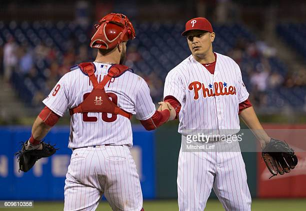 David Hernandez of the Philadelphia Phillies shakes hands with Cameron Rupp after the game against the Chicago White Sox at Citizens Bank Park on...