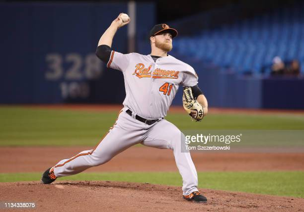 David Hess of the Baltimore Orioles delivers a pitch in the first inning during MLB game action against the Toronto Blue Jays at Rogers Centre on...