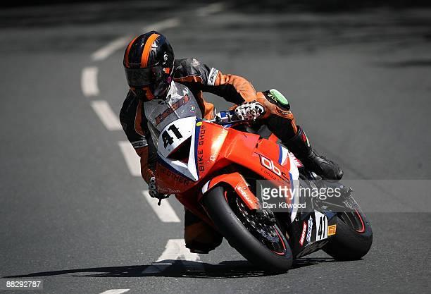 David Hewson takes the corner at Quarterbridge during the superbike TT race in Douglas on June 8 Isle Of Man United Kingdom The annual TT race is one...