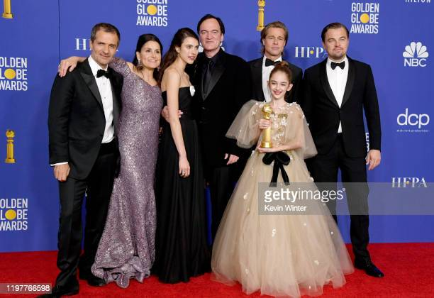 David Heyman Shannon McIntosh Margaret Qualley Quentin Tarantino Brad Pitt Julia Butters and Leonardo DiCaprio pose in the press room with award for...