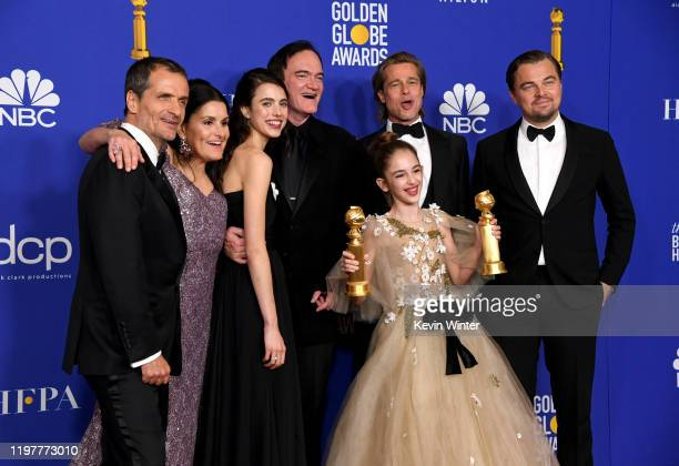 David Heyman, Shannon McIntosh, Margaret Qualley, Quentin Tarantino, Brad Pitt, Julia Butters, and Leonardo DiCaprio pose in the press room with...